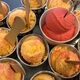A mix of strawberry and pineapple guri guri cups.