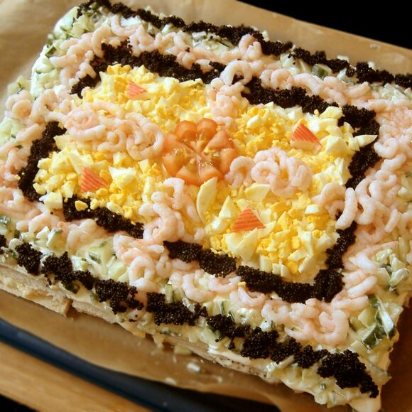 This sandwich cake comes with prawns, egg, caviar, and cucumber.