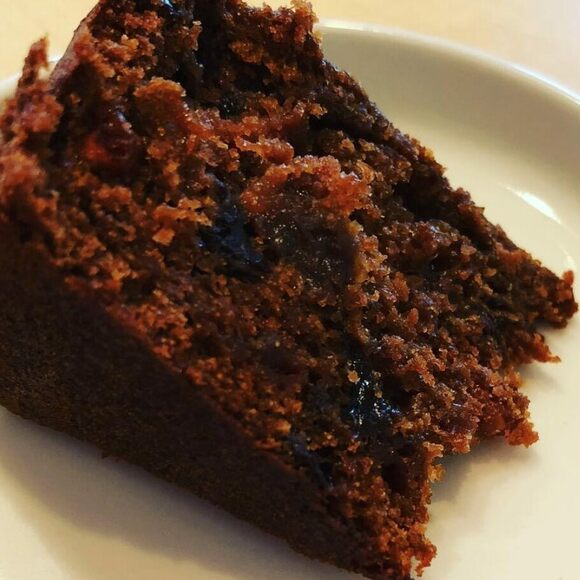 A slice of black cake baked by Mrs. Annemarie Charles, from San Fernando, Trinidad.