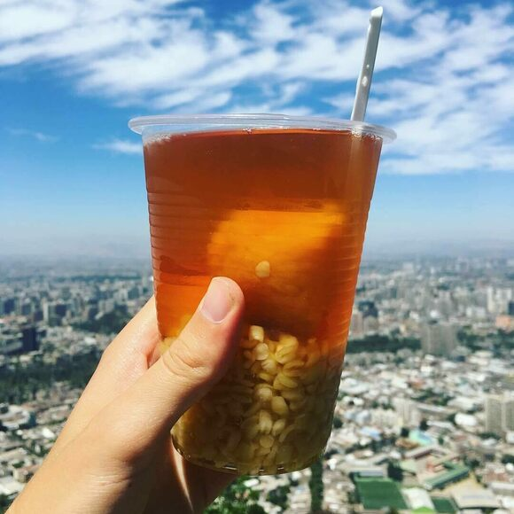 A cup of mote con huesillos pairs especially well with panoramic views of Santiago.