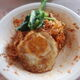 """100 chili """"pedas mampus"""" noodle on the white plate, 25 chili noodles in the background"""