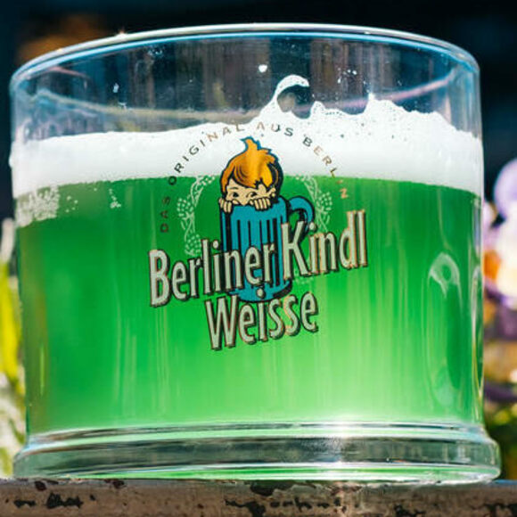 Berliner weisse, flavored with green woodruff syrup. (Yes, that's a child in a mug on the brewery's logo.)