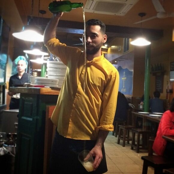 An Asturian cider pour in action.