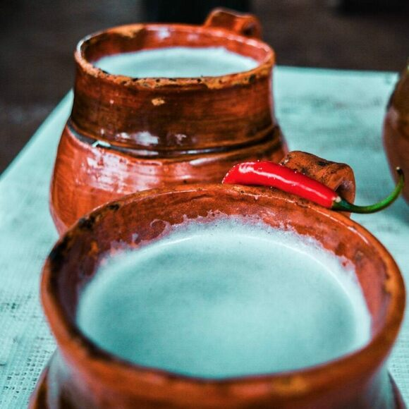 Pitchers of pulque curado.