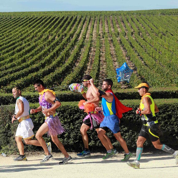 Running past vineyards.