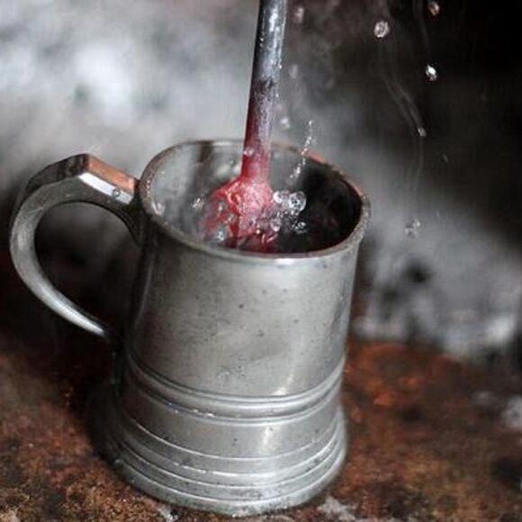 A red-hot loggerhead is thrust into a mug.