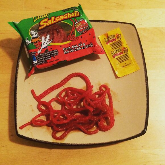 Spicy-sour noodles plus a packet of tamarind sauce equals a delightful snack.