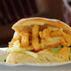 A Gatsby piled high with calamari and chips.