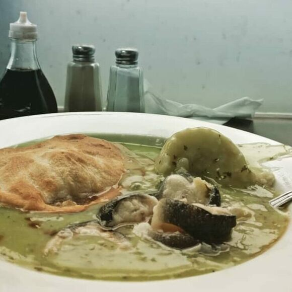 Pie, mash, and eel in parsley sauce.