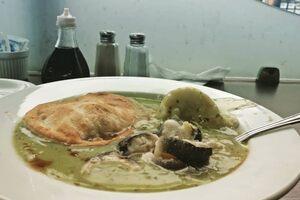 Pie, mash, and eel in parsley sauce.