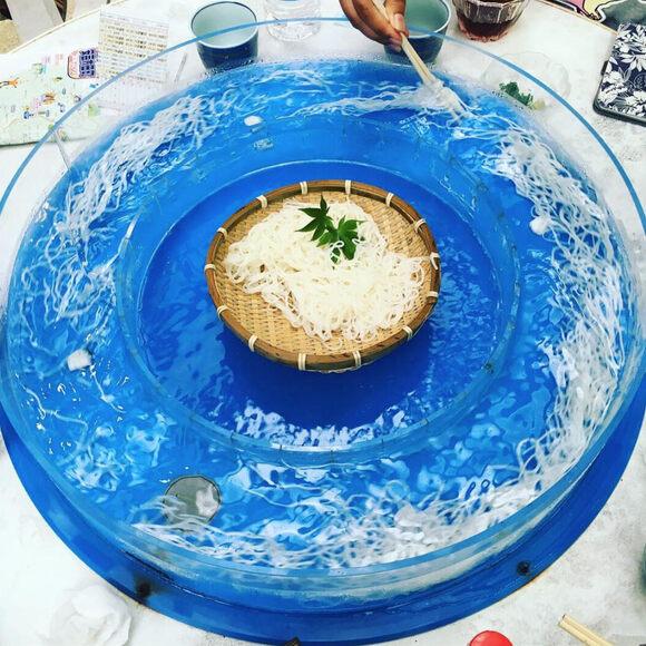 A spinning, circular basin of nagashi somen.
