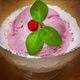 Teaberry ice cream garnished with wintergreen leaves and a teaberry.