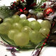 Twelve festive grapes, ready to be eaten.